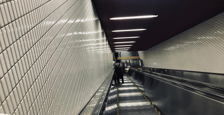 Downward escalator to train station platform in Tokyo